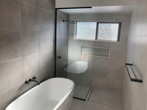 Main Bathroom Floor to ceiling tiles